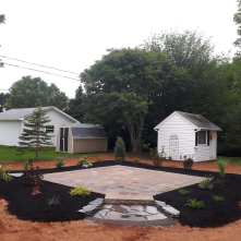 After new stone patio and garden bed